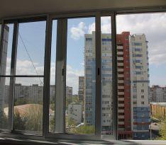 Вид из балкона на город после ремонта