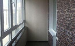 Лоджия с теплым остеклением: отделка стен панелями